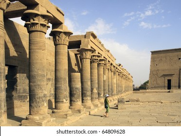 A woman tourist explores the ruins of Philae Temple