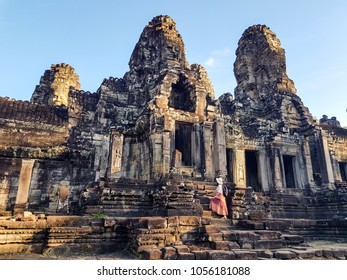 Woman tourist in front of Bayon temple in Angkor Wat