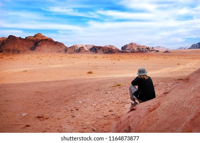 A woman tourist looks at the wonderful landscape view of Wadi Rum, a protected desert wilderness in southern Jordan.