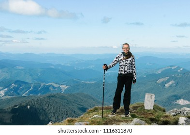 a woman tourist mountain delight on the top