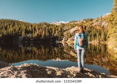 Woman tourist near Bear Lake at autumn in Rocky Mountain National Park. Colorado, USA.