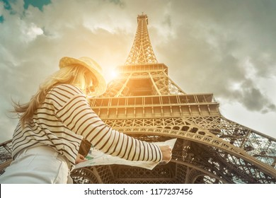 Girl and Eiffel Tower Images, Stock Photos & Vectors