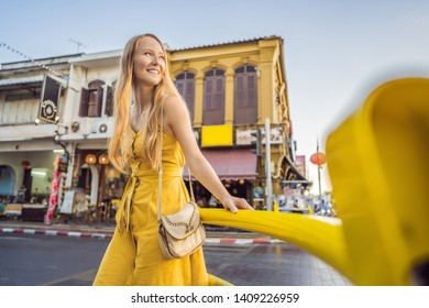 Woman tourist on the Street in the Portugese style Romani in Phuket Town. Also called Chinatown or the old town