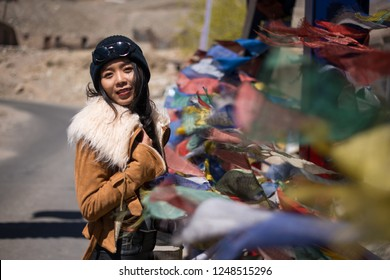 Woman tourist with Praying flags in Leh, Ladakh, India.