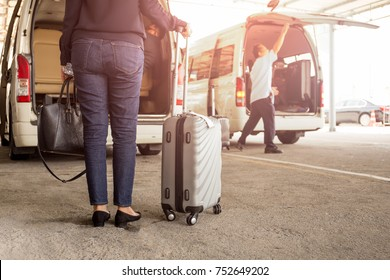 Woman tourist standing with luggage with pick up van at airport