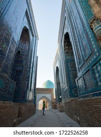 Woman tourist stands near the ancient building in the city of Samarkand in Uzbekistan