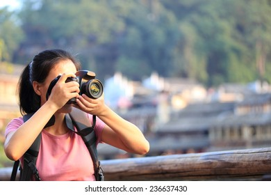 woman tourist taking photo at fenghuang ancient town,china
