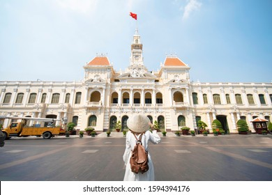 Woman tourist is traveling and sightseeing at Hochiminh people's committee hall landmark of Saigon, Vietnam.