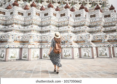 Woman tourist is traveling and sightseeing inside Wat Arun temple in Bangkok, Thailand.