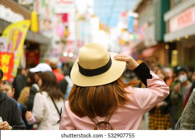 Woman tourist is visiting Harajuku in Tokyo, Japan.