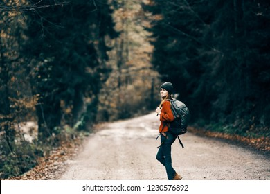 woman tourist walking along a forest road