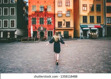 Woman tourist walking in Stockholm travel sightseeing Gamla Stan Stortorget architecture lifestyle summer trip vacations in Sweden
