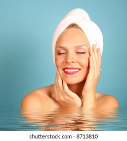 Woman With a Towel on Hair Awaiting Spa Treatment in Water