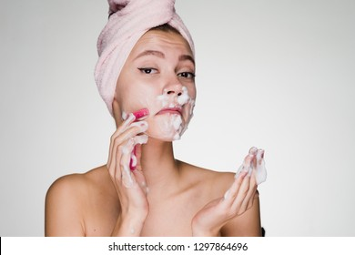 a woman with a towel on her head is going through facial depilation