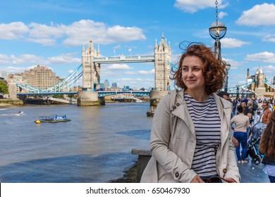 Woman at tower bridge in summer, London