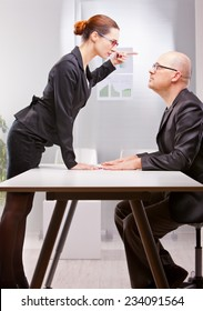 woman towering on a business man standing her outburst