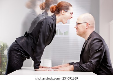 woman towering on a business man firmly standing her outburst