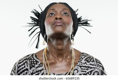 Woman in traditional African dress looking up