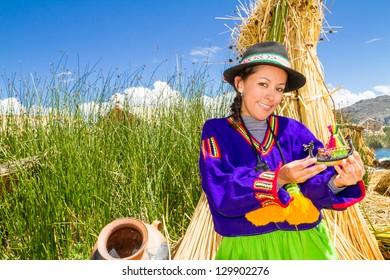 Woman in traditional clothes, lake Titicaca Puno Peru South America
