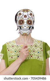 Woman in traditional clothing wearing skull mask Catrina celebrating Day of the Dead.