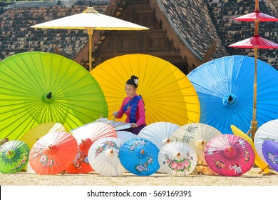 The Woman In Traditional Costume painting umbrella,chiangmai Thailand