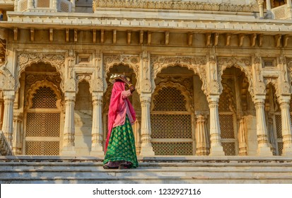 A woman in traditional dress at ancient temple in Jodhpur, India.