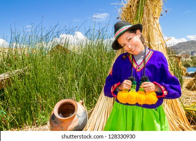 Woman in traditional indian clothing in uros, Titicaca lake Peru