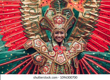 Woman in traditional Indonesian costume of Garuda during ritual dance ceremony