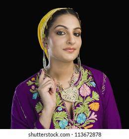 Woman in traditional Kashmiri dress gesturing