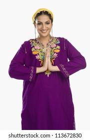 Woman in traditional Kashmiri dress greeting