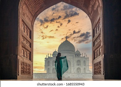Woman in traditonal culture dress saree or sari in the Taj Mahal, Taj Mahal is most beautiful white marble mausoleum in the Indian city, Agra, Uttar Pradesh, India.