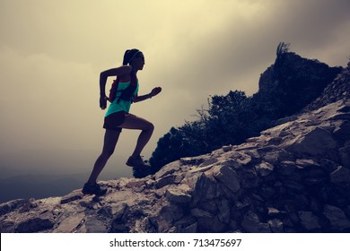 woman trail runner running on the great wall top of mountain