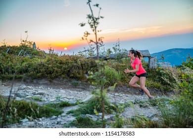 Woman trail running in mountains. Szczyrk, Beskidy Mountains, Silesian Beskid, Poland