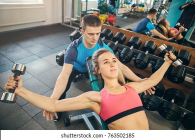 Woman train with a coach in jym
