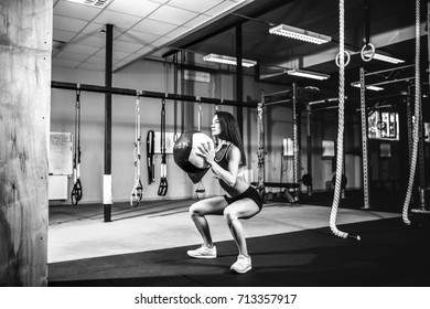 Woman training with functional gymnastic ball in the gym