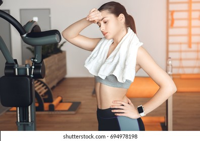 Woman training in gym body health fit care