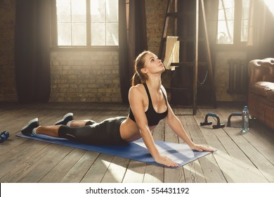Woman training hard with push up exercise in her gym
