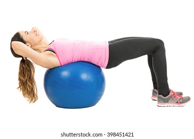 Woman training her abs on pilates ball