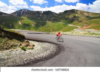 Woman training on a bike on mountain road