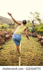 woman training on a slack line