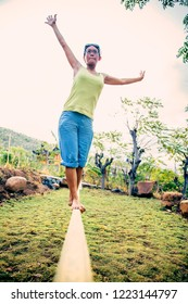 woman training on a slack line