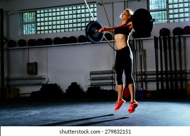 Woman training snatch at gym