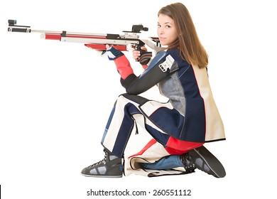 Woman training sport shooting with air rifle gun.