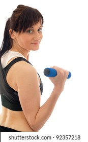 woman is training with weights in a gym