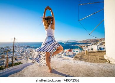 Woman training yoga in Mykonos, Greece