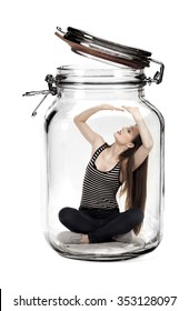 Woman trapped in glass jar as a stress concept.