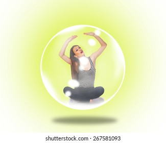 Woman trapped inside a soap bubble over yellow background.