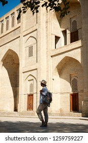 Woman Travaler in Central Asia Mosque Vault Entrance. Caucasian Female Standing  on Historical Landmark