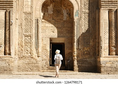 Woman Travaler in Central Asia Mosque Vault Entrance. Caucasian Female Standing on Historical Landmark.