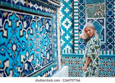 Woman Travaler on East Asia Mosque Vault Backdrop. Caucasian Female Standing in Islamic Ceramic Ornament Temple Dome. Mosaic Arch Historical Landmark.
